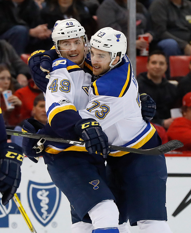 . St. Louis Blues center Ivan Barbashev (49) celebrates his goal against the Detroit Red Wings with Kenny Agostino (73)in the first period of an NHL hockey game, Wednesday, Feb. 15, 2017, in Detroit. (AP Photo/Paul Sancya)