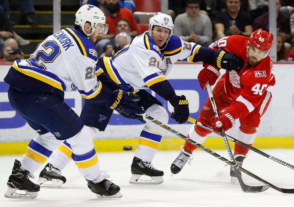 . Detroit Red Wings left wing Henrik Zetterberg (40) shoots as St. Louis Blues left wing Alexander Steen (20) defends in the second period of an NHL hockey game, Wednesday, Feb. 15, 2017, in Detroit. (AP Photo/Paul Sancya)