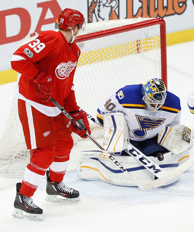 . St. Louis Blues goalie Carter Hutton (40) blocks a Detroit Red Wings\' Anthony Mantha (39) shot in the third period of an NHL hockey game Wednesday, Feb. 15, 2017, in Detroit. St. Louis won 2-0. (AP Photo/Paul Sancya)