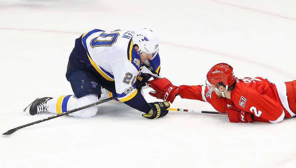 . Detroit Red Wings defenseman Brendan Smith (2) holds onto St. Louis Blues left wing Alexander Steen (20) in the third period of an NHL hockey game Wednesday, Feb. 15, 2017, in Detroit. St. Louis won 2-0. (AP Photo/Paul Sancya)