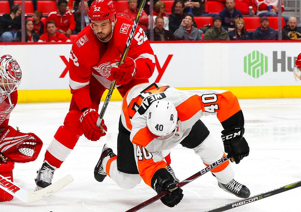 . Detroit Red Wings defenseman Jonathan Ericsson (52) checks Philadelphia Flyers center Jordan Weal (40) in the third period of an NHL hockey game Tuesday, March 20, 2018, in Detroit. (AP Photo/Paul Sancya)