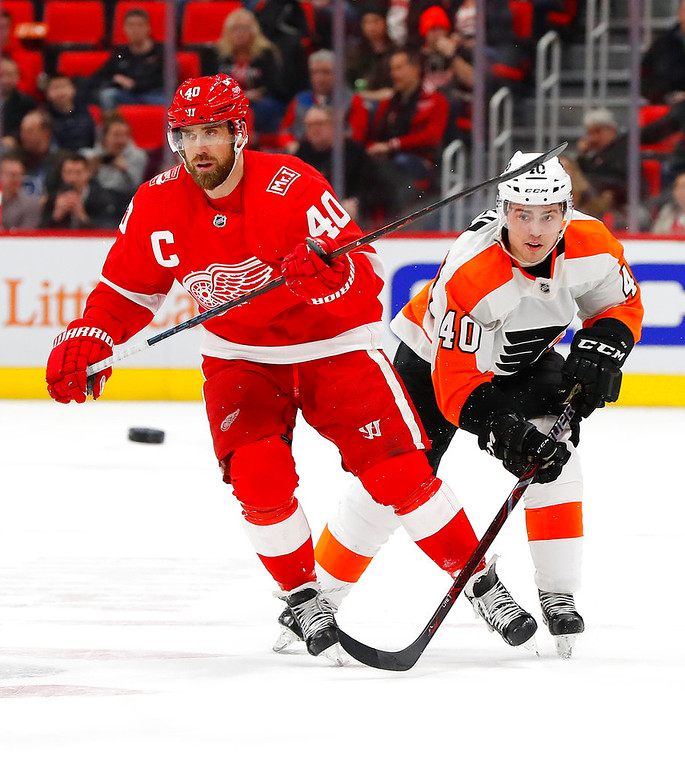 . Detroit Red Wings center Henrik Zetterberg (40) and Philadelphia Flyers center Jordan Weal (40) chase the puck in the second period of an NHL hockey game Tuesday, March 20, 2018, in Detroit. (AP Photo/Paul Sancya)