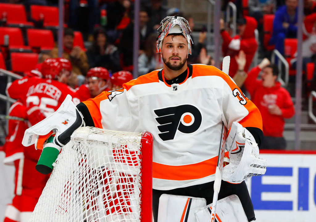 . Philadelphia Flyers goaltender Petr Mrazek (34) plays against the Detroit Red Wings in the second period of an NHL hockey game Tuesday, March 20, 2018, in Detroit. (AP Photo/Paul Sancya)