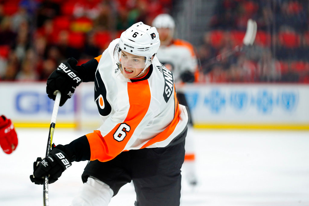 . Philadelphia Flyers defenseman Travis Sanheim (6) shoots against the Detroit Red Wings in the first period of an NHL hockey game Tuesday, March 20, 2018, in Detroit. (AP Photo/Paul Sancya)
