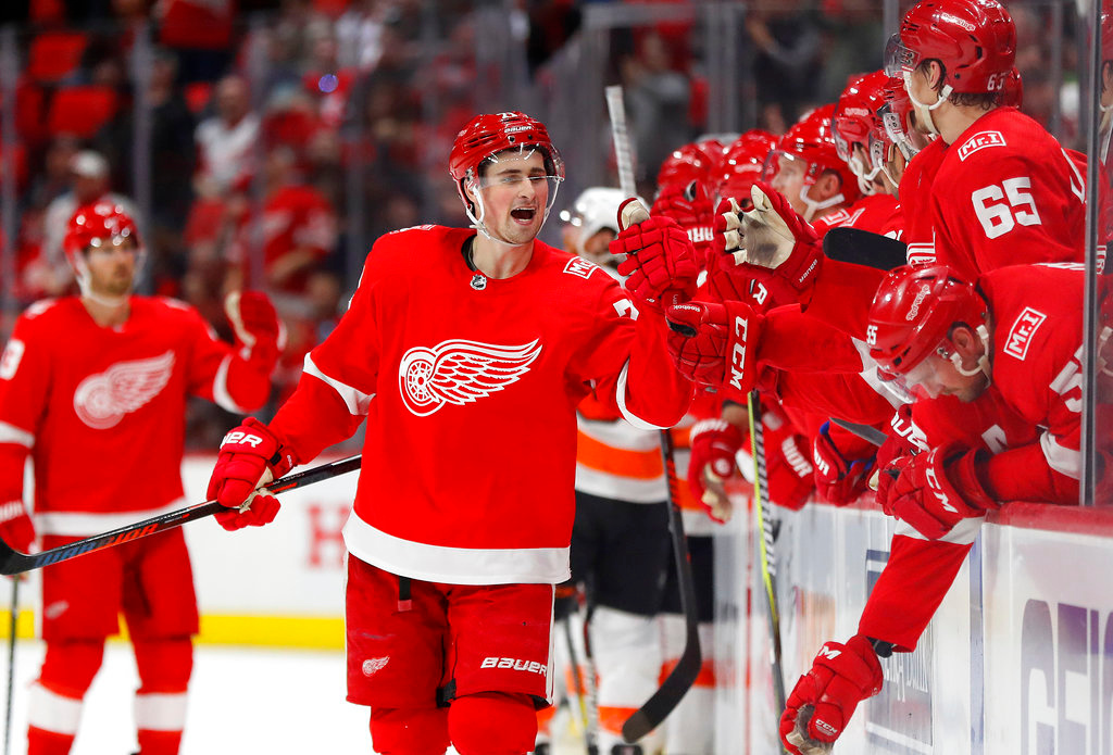 . Detroit Red Wings center Dylan Larkin (71) celebrates his goal against the Philadelphia Flyers during the third period of an NHL hockey game Tuesday, March 20, 2018, in Detroit. (AP Photo/Paul Sancya)