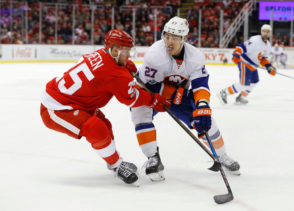 . Detroit Red Wings defenseman Mike Green (25) defends New York Islanders left wing Anders Lee (27) in the first period of an NHL hockey game Tuesday, Feb. 21, 2017, in Detroit. (AP Photo/Paul Sancya)