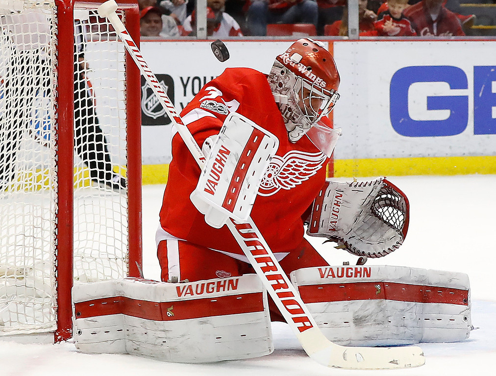 . Detroit Red Wings goalie Petr Mrazek (34) deflects a New York Islanders shot in the first period of an NHL hockey game Tuesday, Feb. 21, 2017, in Detroit. (AP Photo/Paul Sancya)