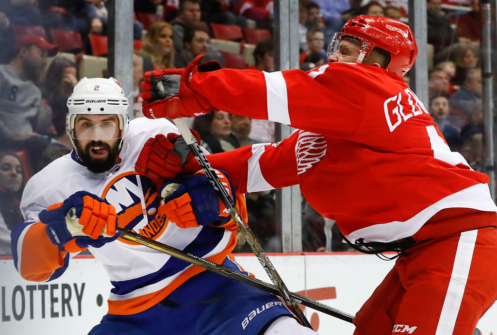 . Detroit Red Wings center Luke Glendening (41) checks New York Islanders defenseman Nick Leddy (2) in the second period of an NHL hockey game, Tuesday, Feb. 21, 2017, in Detroit. (AP Photo/Paul Sancya)