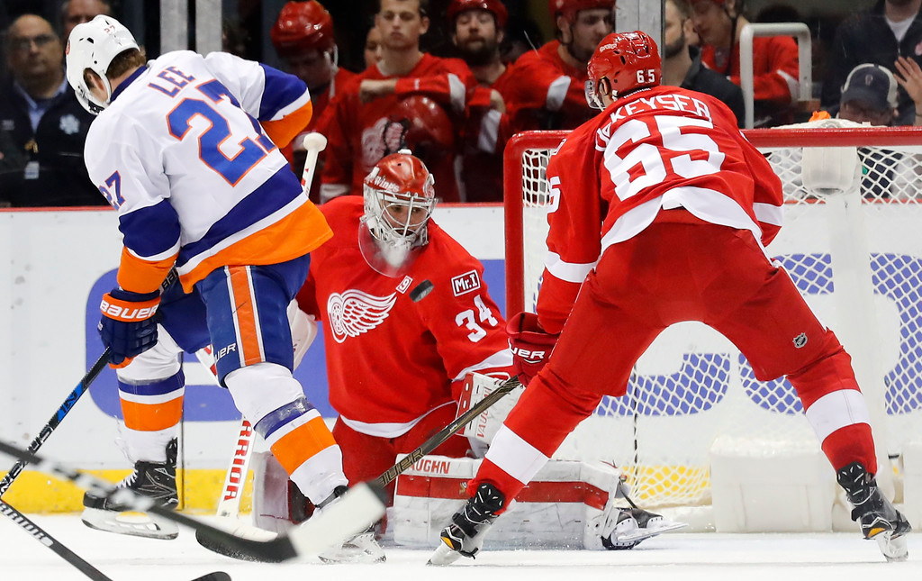 . Detroit Red Wings goalie Petr Mrazek (34) stops a New York Islanders left wing Anders Lee (27) shot in the second period of an NHL hockey game Tuesday, Feb. 21, 2017, in Detroit. (AP Photo/Paul Sancya)