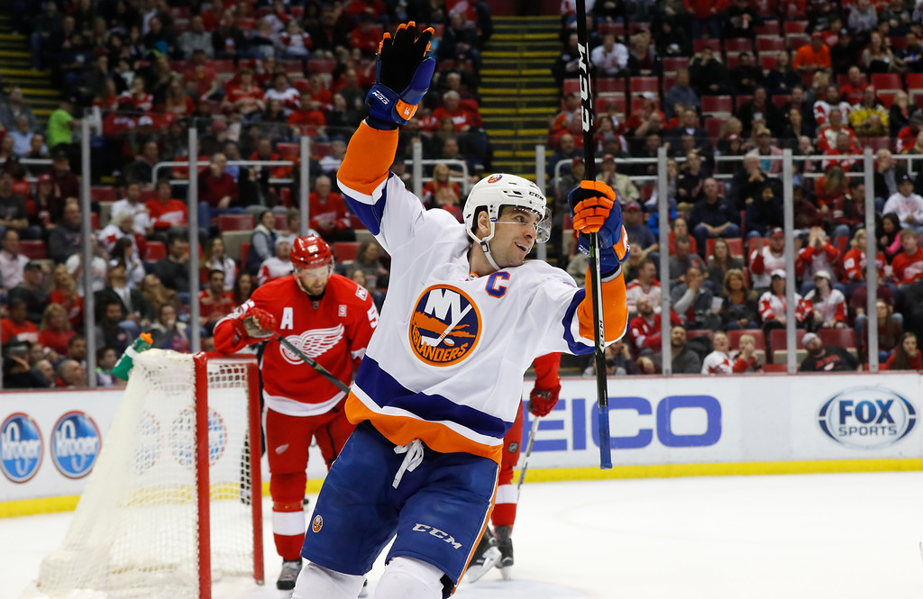 . New York Islanders center John Tavares (91) celebrates a Josh Bailey (12) goal against the Detroit Red Wings in the first period of an NHL hockey game Tuesday, Feb. 21, 2017, in Detroit. (AP Photo/Paul Sancya)