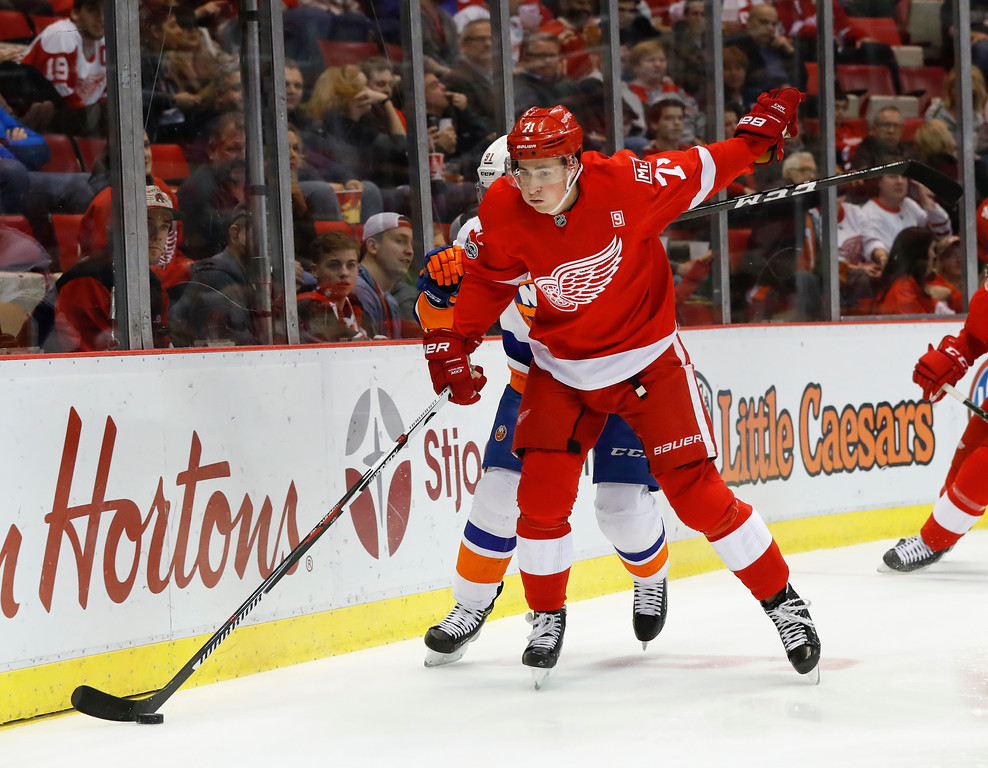 . Detroit Red Wings center Dylan Larkin (71) chases the puck against the New York Islanders in the first period of an NHL hockey game Tuesday, Feb. 21, 2017, in Detroit. (AP Photo/Paul Sancya)