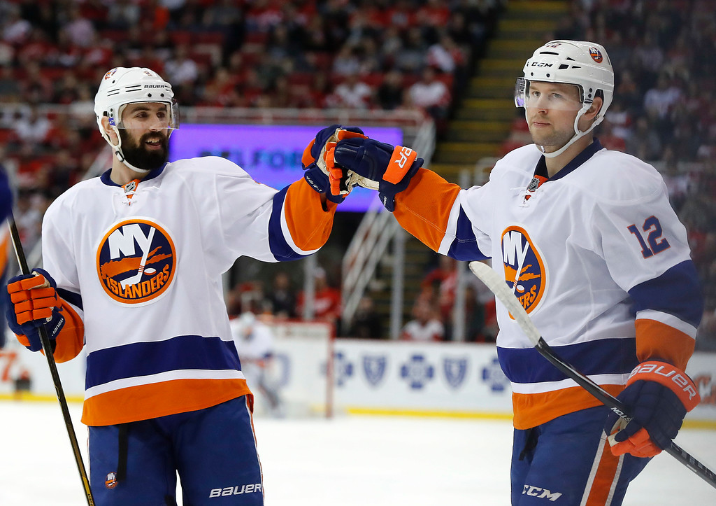 . New York Islanders left wing Josh Bailey (12) celebrates his goal against the Detroit Red Wings with Nick Leddy in the first period of an NHL hockey game, Tuesday, Feb. 21, 2017, in Detroit. (AP Photo/Paul Sancya)