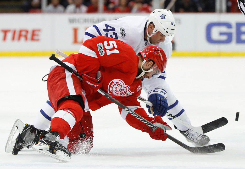 . Detroit Red Wings center Frans Nielsen (51) and Toronto Maple Leafs center Nazem Kadri (43) try to control a face-off in the first period of an NHL hockey game Wednesday, Jan. 25, 2017, in Detroit. (AP Photo/Paul Sancya)