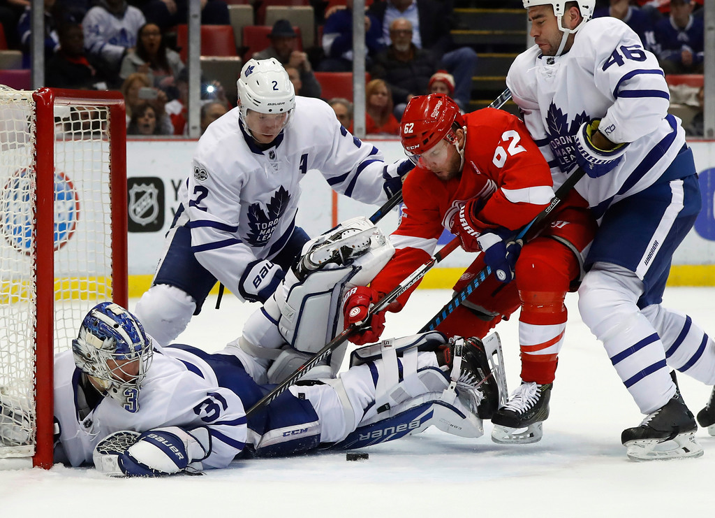 . Toronto Maple Leafs goalie Frederik Andersen (31) stops a Detroit Red Wings left wing Thomas Vanek (62) shot in the second period of an NHL hockey game Wednesday, Jan. 25, 2017, in Detroit. (AP Photo/Paul Sancya)