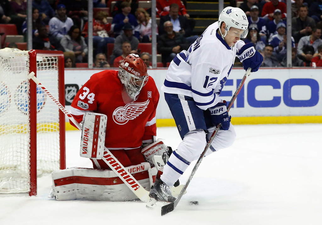 . Detroit Red Wings goalie Petr Mrazek (34) stops a shot as Toronto Maple Leafs right wing Connor Brown (12) sets a screen in the first period of an NHL hockey game Wednesday, Jan. 25, 2017, in Detroit. (AP Photo/Paul Sancya)