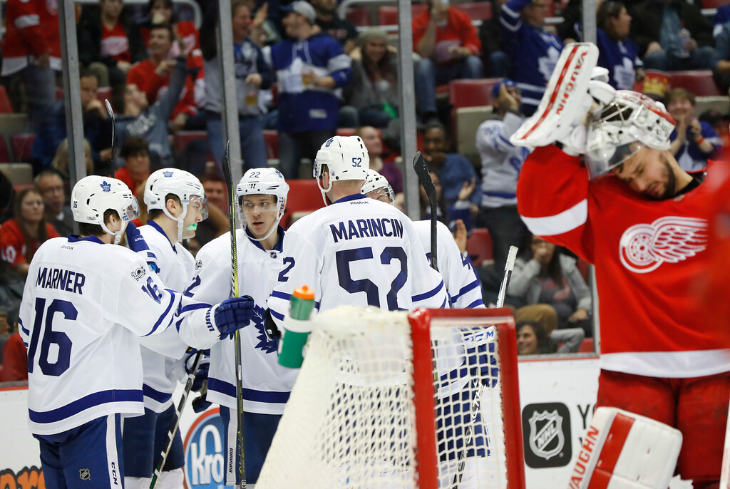 . Toronto Maple Leafs left wing James van Riemsdyk, second from left, celebrates his goal against the Detroit Red Wings in the third period of an NHL hockey game Wednesday, Jan. 25, 2017, in Detroit. (AP Photo/Paul Sancya)
