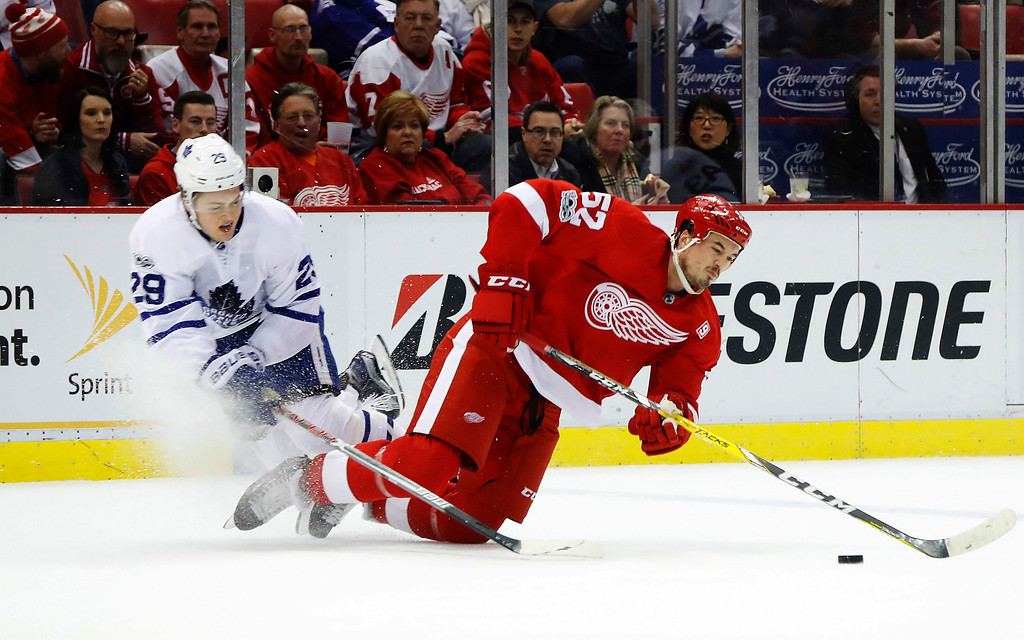 . Toronto Maple Leafs center William Nylander (29) and Detroit Red Wings defenseman Jonathan Ericsson (52) fall while trying to control the puck in the first period of an NHL hockey game Wednesday, Jan. 25, 2017, in Detroit. (AP Photo/Paul Sancya)