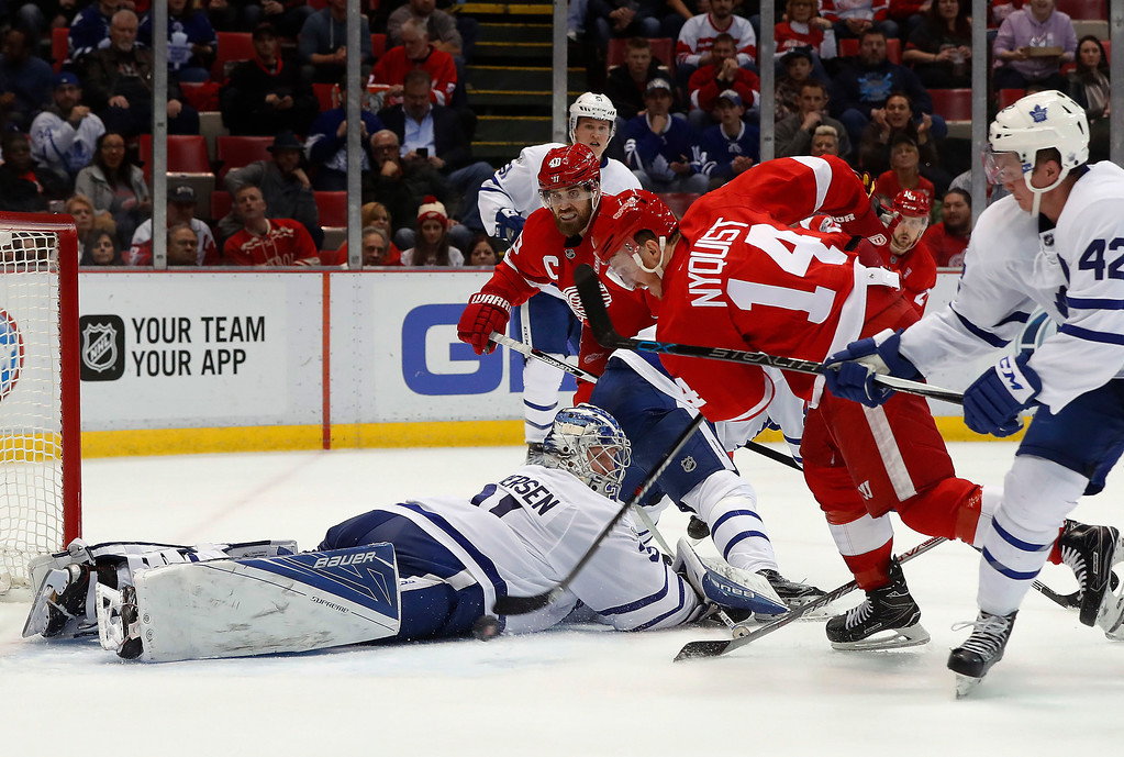 . Toronto Maple Leafs goalie Frederik Andersen (31) stops a Detroit Red Wings right wing Gustav Nyquist (14) shot in the second period of an NHL hockey game Wednesday, Jan. 25, 2017, in Detroit. (AP Photo/Paul Sancya)