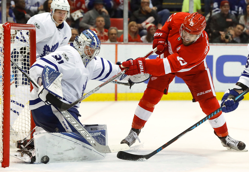 . Toronto Maple Leafs goalie Frederik Andersen (31) stops a Detroit Red Wings center Riley Sheahan (15) shot in the second period of an NHL hockey game Wednesday, Jan. 25, 2017, in Detroit. (AP Photo/Paul Sancya)