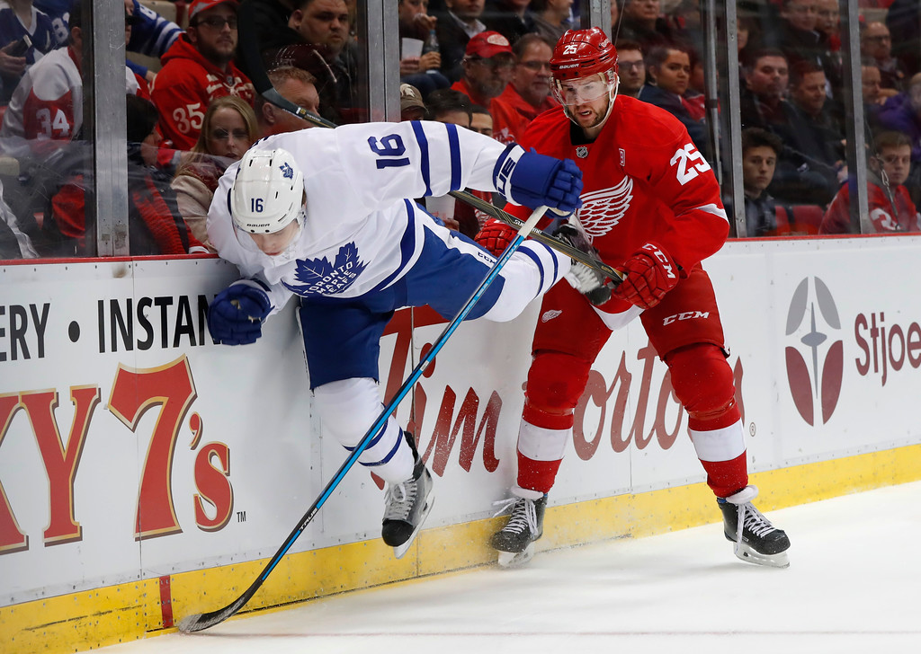 . Detroit Red Wings defenseman Mike Green (25) checks Toronto Maple Leafs center Mitchell Marner (16) in the first period of an NHL hockey game Wednesday, Jan. 25, 2017, in Detroit. (AP Photo/Paul Sancya)