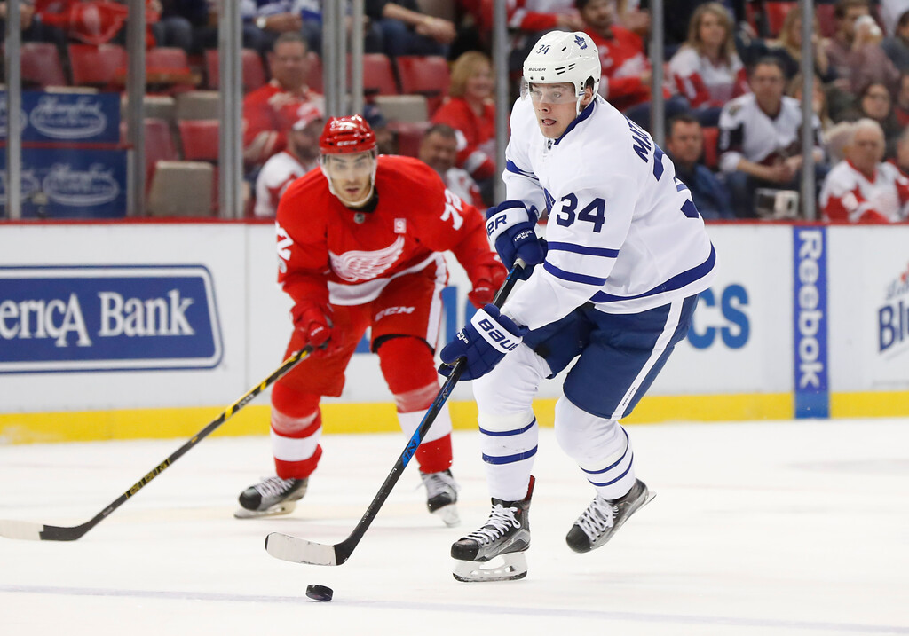 . Toronto Maple Leafs center Auston Matthews (34) carries the puck against the Detroit Red Wings in the first period of an NHL hockey game Wednesday, Jan. 25, 2017, in Detroit. (AP Photo/Paul Sancya)