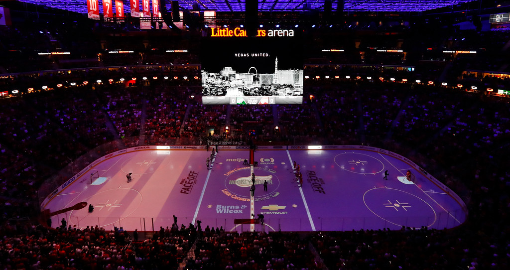 . A moment of silence for the mass shooting in Las Vegas is held before the first period of an NHL hockey game between the Detroit Red Wings and Minnesota Wild, Thursday, Oct. 5, 2017, in Detroit. The video board reads Vegas Strong. (AP Photo/Paul Sancya)
