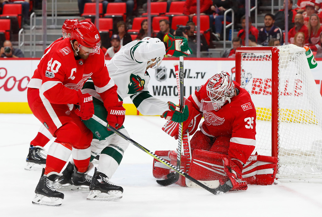 . Detroit Red Wings goalie Jimmy Howard (35) stops a Minnesota Wild left wing Jason Zucker (16) shot in the third period of an NHL hockey game Thursday, Oct. 5, 2017, in Detroit. Detroit won 4-2. (AP Photo/Paul Sancya)