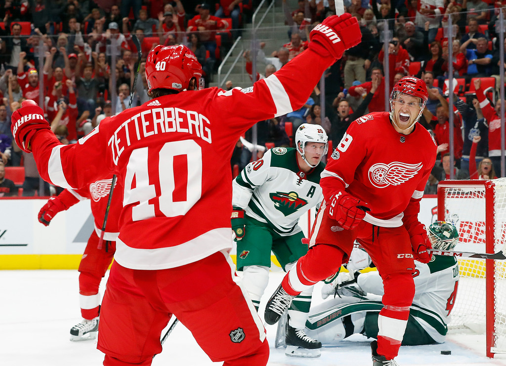 . Detroit Red Wings\' Anthony Mantha (39) celebrates his goal with Henrik Zetterberg, of Sweden (40) against the Minnesota Wild in the second period of an NHL hockey game Thursday, Oct. 5, 2017, in Detroit. (AP Photo/Paul Sancya)