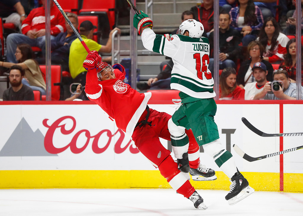 . Minnesota Wild left wing Jason Zucker (16) checks Detroit Red Wings defenseman Trevor Daley (83) in the third period of an NHL hockey game Thursday, Oct. 5, 2017, in Detroit. (AP Photo/Paul Sancya)