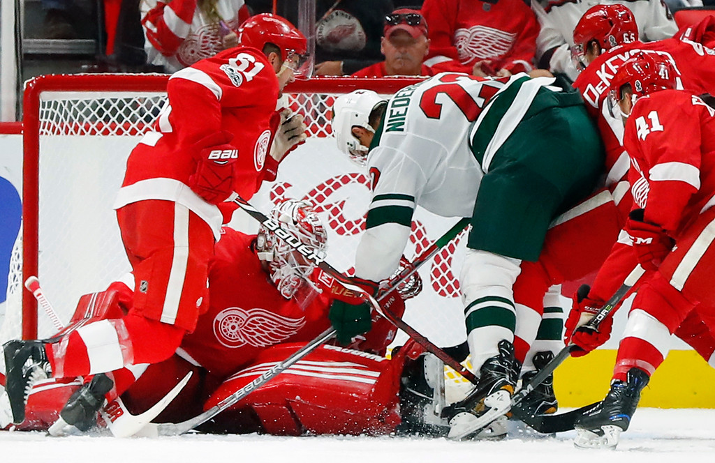 . Detroit Red Wings goalie Jimmy Howard (35) stops a shot by Minnesota Wild Nino Niederreiter, of Switzerland, (22)  on a power play in the second period of an NHL hockey game Thursday, Oct. 5, 2017, in Detroit. (AP Photo/Paul Sancya)