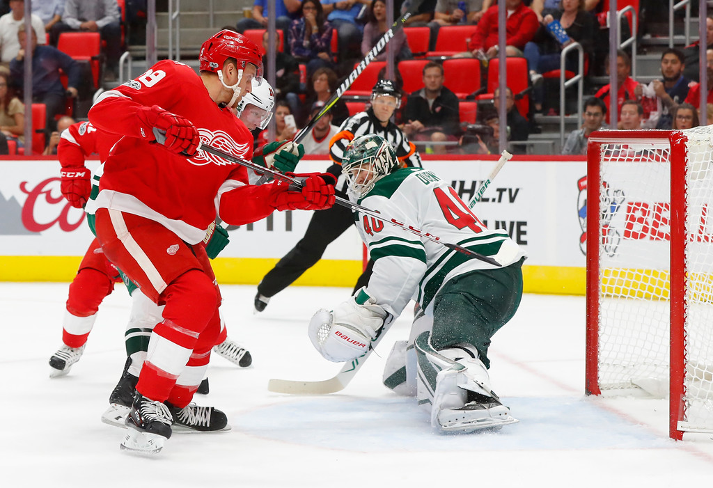 . Detroit Red Wings right wing Anthony Mantha (39) scores on Minnesota Wild goalie Devan Dubnyk (40) in the second period of an NHL hockey game Thursday, Oct. 5, 2017, in Detroit. (AP Photo/Paul Sancya)