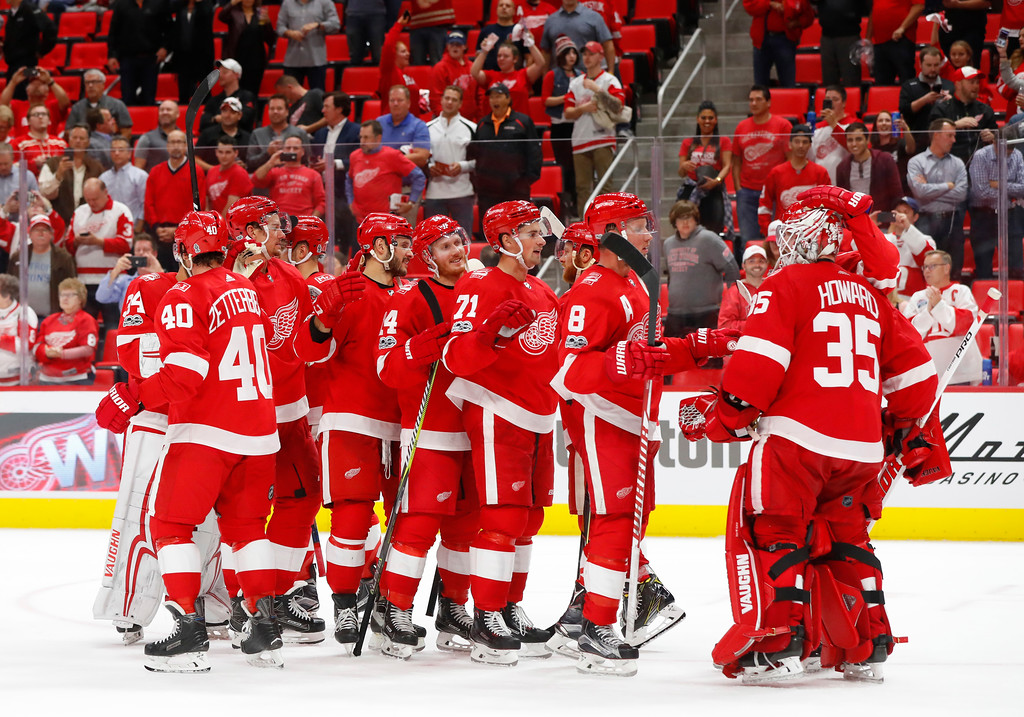 . Detroit Red Wings players congratulate goalie Jimmy Howard (35) after an NHL hockey game against the Minnesota Wild, Thursday, Oct. 5, 2017, in Detroit. Detroit won 4-2. (AP Photo/Paul Sancya)