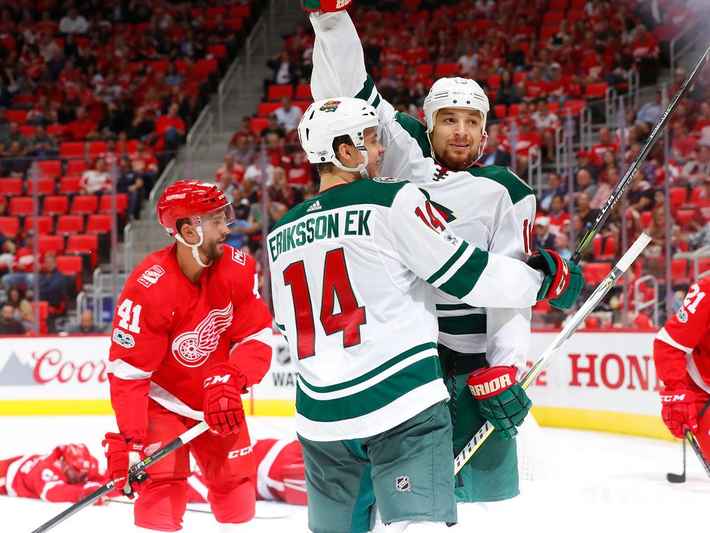 . Minnesota Wild right wing Chris Stewart (10) celebrates his goal with Joel Eriksson Ek, of Sweden (14) against the Detroit Red Wings in the third period of an NHL hockey game Thursday, Oct. 5, 2017, in Detroit. (AP Photo/Paul Sancya)