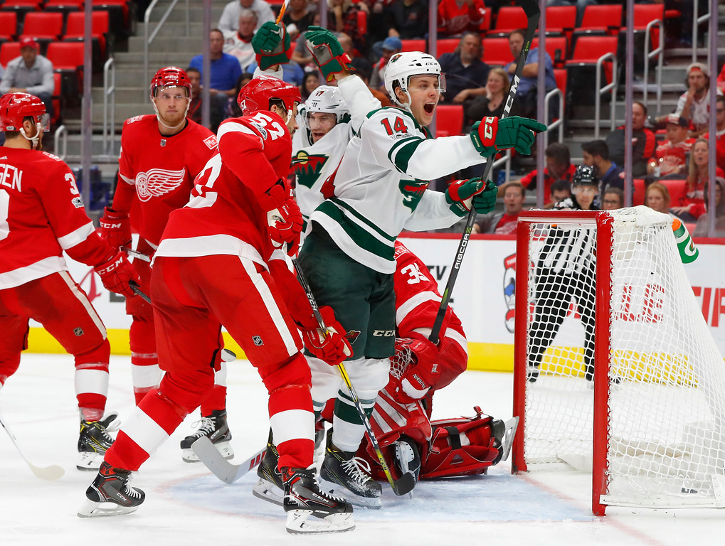 . Minnesota Wild center Joel Eriksson Ek, of Sweden (14) celebrates his goal against the Detroit Red Wings in the third period of an NHL hockey game Thursday, Oct. 5, 2017, in Detroit. (AP Photo/Paul Sancya)