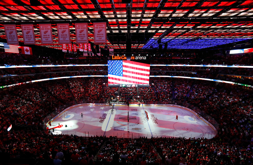 . The national anthem is played before the Detroit Red Wings-Minnesota Wild NHL hockey game Thursday, Oct. 5, 2017, in Detroit. (AP Photo/Paul Sancya)