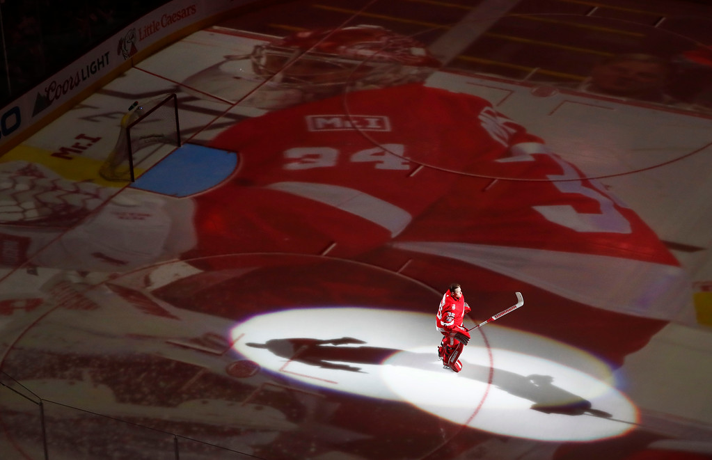 . Detroit Red Wings goalie Jimmy Howard (35) is introduced before the first period of an NHL hockey game against the Minnesota Wild, Thursday, Oct. 5, 2017, in Detroit. (AP Photo/Paul Sancya)