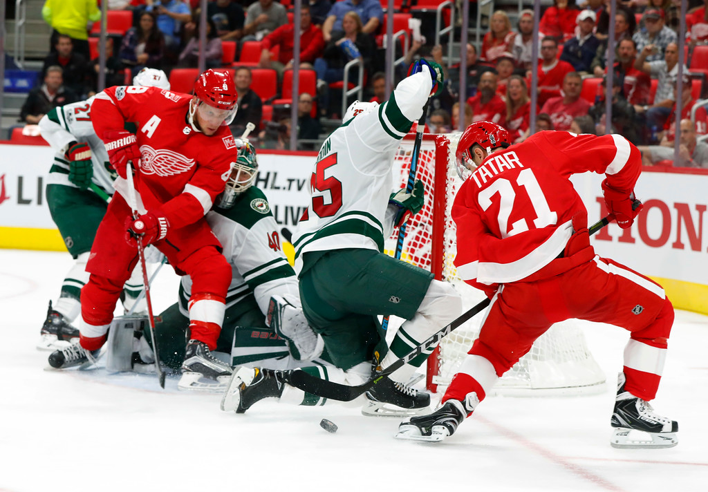 . Minnesota Wild defenseman Jonas Brodin, of Sweden (25) blocks a Detroit Red Wings left wing Tomas Tatar, of Slovakia, (21) shot in the second period of an NHL hockey game Thursday, Oct. 5, 2017, in Detroit. (AP Photo/Paul Sancya)