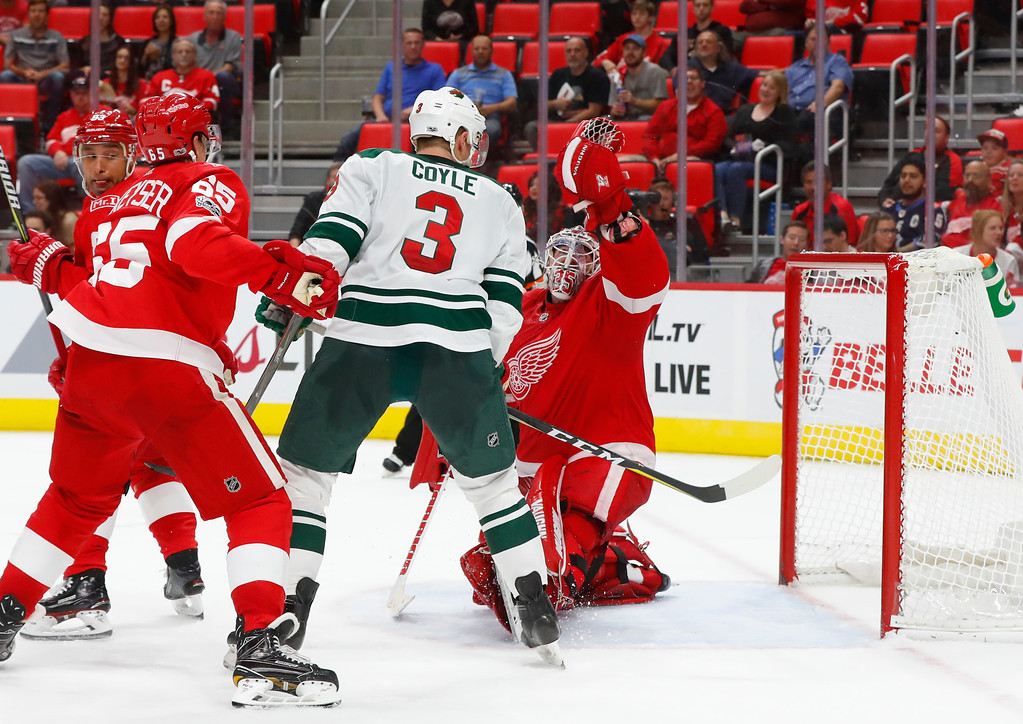 . Detroit Red Wings goalie Jimmy Howard (35) stops a Minnesota Wild shot in the third period of an NHL hockey game Thursday, Oct. 5, 2017, in Detroit. Detroit won 4-2. (AP Photo/Paul Sancya)