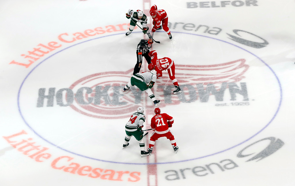 . The puck drops for the Detroit Red Wings-Minnesota Wild NHL hockey game in the first period, Thursday, Oct. 5, 2017, in Detroit. (AP Photo/Paul Sancya)
