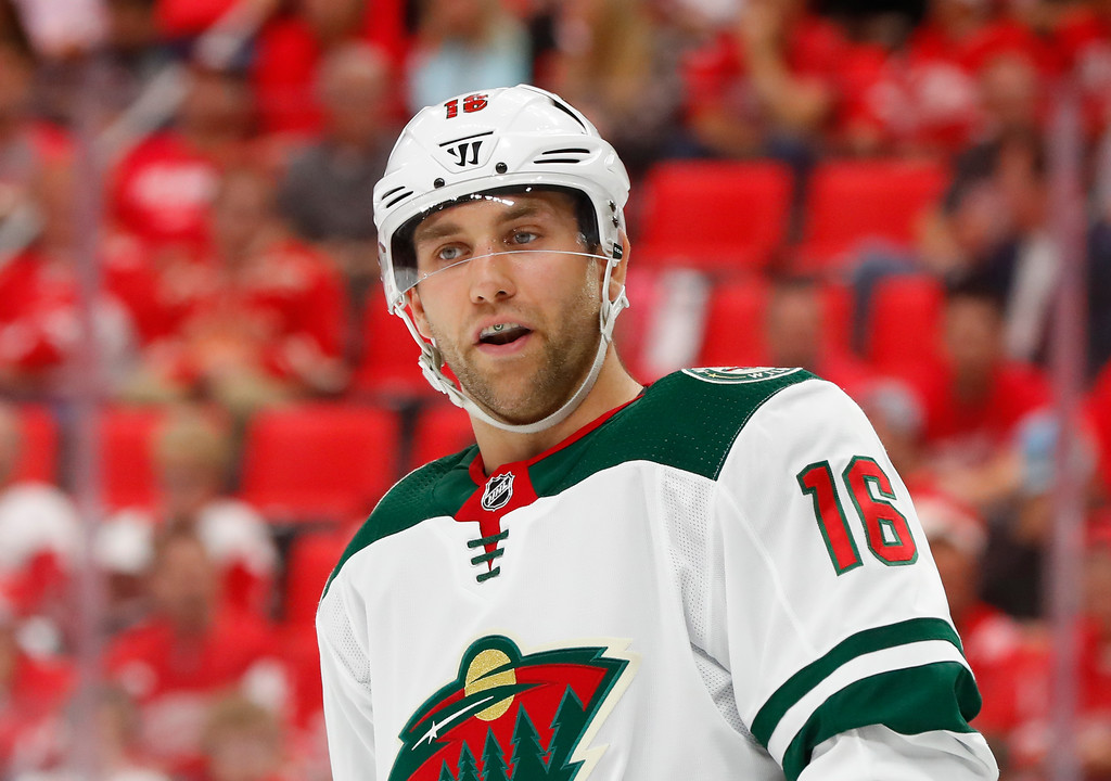 . Minnesota Wild left wing Jason Zucker (16) plays against the Detroit Red Wings in the first period of an NHL hockey game Thursday, Oct. 5, 2017, in Detroit. (AP Photo/Paul Sancya)