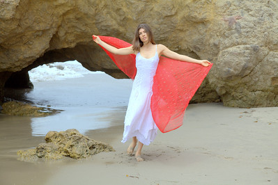 Pretty model with white dress & red scarf.