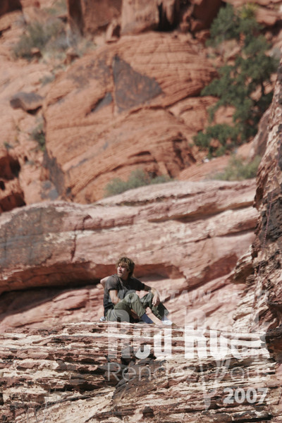 Chris Sharma takes a break from his Redpoint Clinic in Red Rocks, Nevada.