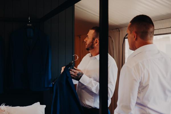 12_H+J_Groom_Prep_at_Sandstone_Point_Hotel_She_Said_Yes_Wedding_Photography_Brisbane