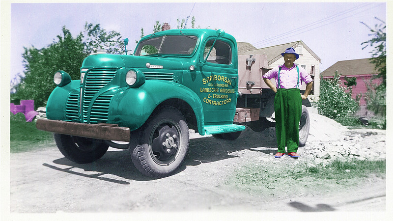 Layered - still needs more colorization, more restoration and COLOR INPUT.  That's why I posted - so you can get an idea of what all I'm doing. Any of the individual colors can and will be individually adjusted. I use intentionally ridiculous colors like this to ensure I can get some input. The PRIMARY thing I'm concerned about is the truck and lettering colors. His clothes and things like the barrels I can obviously figure out, and I won't leave a pink house in the background. <br /> <br /> So.... what colors for the truck?