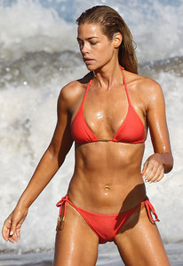 Denise Richards was caught having an early morning swim in a bright orange bikini on her last day of her family vacation in Maui, Hawaii.  Pictured: Denise Richards  Ref: SPL109674  270609   EXCLUSIVE Picture by: D. Shook / Splash News  Splash News and Pictures Los Angeles:	310-821-2666 New York:	212-619-2666 London:	870-934-2666 photodesk@splashnews.com  Redheads (Not Woodpeckers)