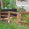 "The first three sections are done.  My first attempt at this gate was a dual-gate, but the slope of the property made it exceptionally difficult to hang (imagine second post missing).  Nothing lined up and I lack the carpenter skills to make a really nice ""funky"" sloped gate.    <br /> <br /> There are trim pieces framing the gate.  Became necessary  to hold on the hinges.  It looked butt-ugly mounting the gate between the posts. ..."