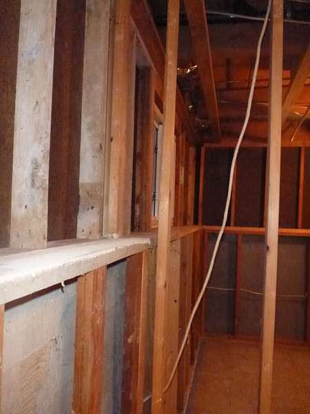 Standing in middle guest room looking into SE  corner room.