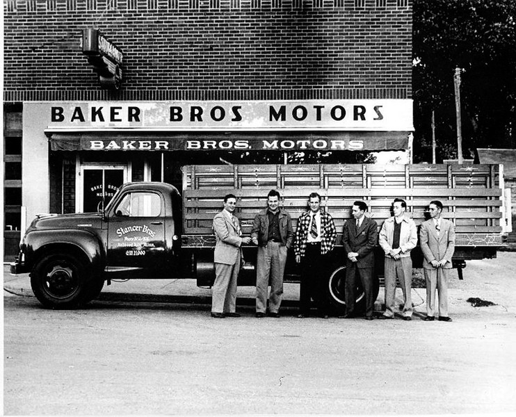 Baker Bros 1948 - I am not sure if this building shown here was on Mill Street or not, but I think it was.  I could use your help on this first photo.   If you know for sure where it was located, please let me know.  It looks like it is situated on an alley.  I am sure that this photo was taken in the 1940s, and perhaps close to 1948-1949.  This was a Studebaker dealership.  The name Studebaker is on the sign above the front door.  See the next picture or scan on Baker Brother's Motors and read the history.  - Roger Breckenridge
