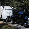 Tow vehicle and travel trailer parked at Reed Bingham State Park.