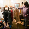 Jeannie Bartovics, Site Administrator of the Reed Homestead in Townsend, shows off aspects of the historical home built in 1809. Pictured are articles of clothing from the 1800's. SENTINEL & ENTERPRISE / Ashley Green